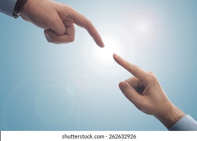 Two fingers barely touching each other, can be used to stress support, investment, start up, angel investor