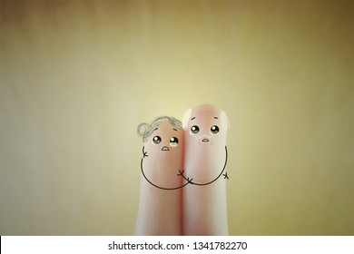 Two fingers decorated as two old people. They are lonely and helpless.