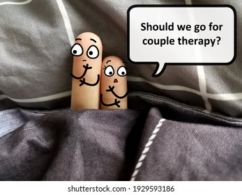 Two fingers are decorated as two person. One of them is asking if they should go for couple therapy.