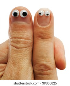 Two fingers of hands with doll eyes