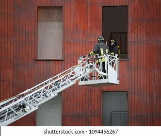 two firefighters in action during a practice at fire barracks
