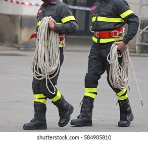 two firefighters with a long rope during the rescue operation