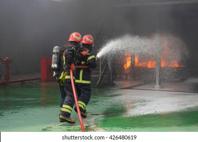 Two firemen fighting the fire