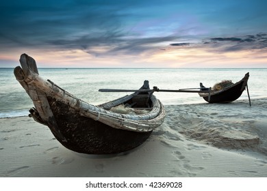 Two fisherman boats at sunrise time on the beach