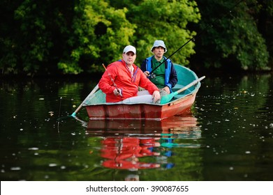 Two fishermen fish in the boat