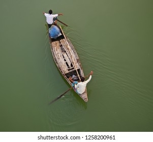 Two fishermen riding on a boat unique photo