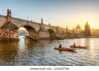 Two fishermen under the Charles bridge in Prague at the morning.