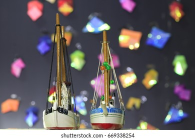 two fishing boat  model and many color bokeh