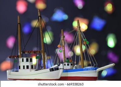 two fishing boat models and many color bokeh