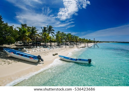 two fishing boats in Catalina island beach, a desert island near Punta Cana , Dominican Republic