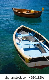 Two fishing boats floating on the water