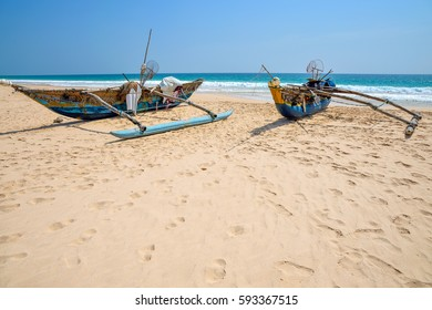 Two fishing boats on the ocean shore