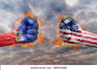 Two fist with the flag of Haiti and USA faced at each other ready for fight