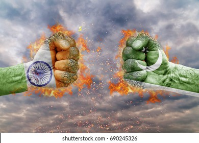 Two fist with the flag of India and Pakistan faced at each other ready for fight