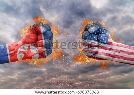 Two fist with the flag of North Korea and USA faced at each other ready for fight