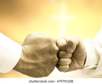 two fists hitting each other  Business