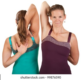 Two fit women stretch their shoulders over white background