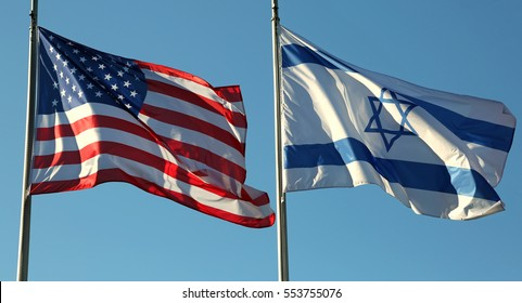 two flags: American and Israeli waving in the blue sky
