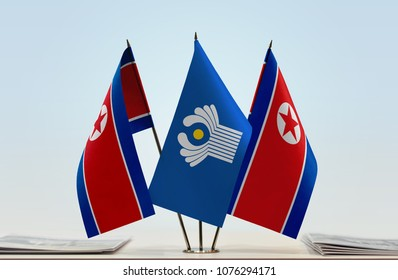 Two flags of North Korea and CIS flag between