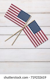 Two flags on a painted wood background
