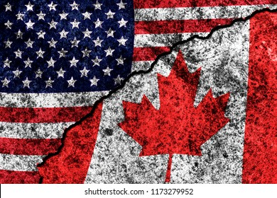 two flags of the USA and Canada on a cracked concrete wall