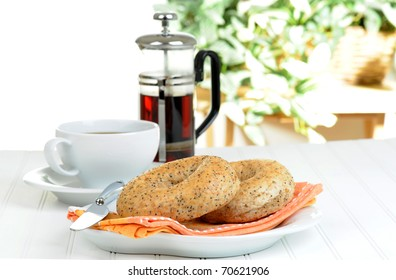 Two flax bagels on a plate served with coffee.