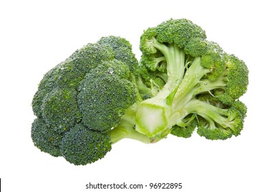 Two florets of fresh green broccoli.  Shot on white background.