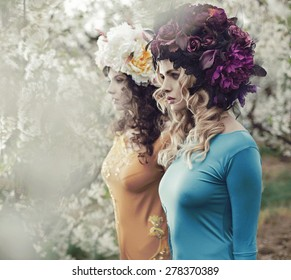 Two flower nymphs in a spring orchard