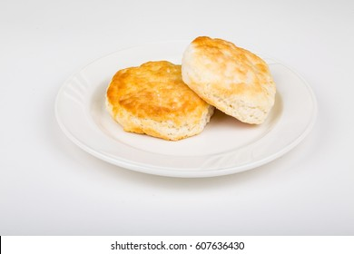 Two Fluffy Biscuits on a White Plate and Background