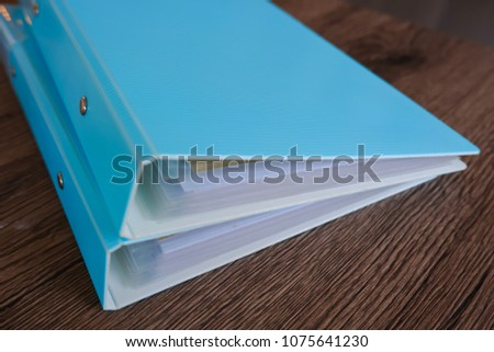 Two folder on wooden table