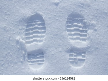 Two footprints in powder snow, vertical perspective