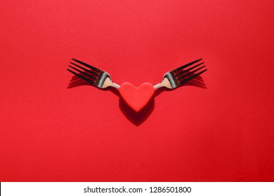 Two forks and a heart. The concept of Valentine's Day and a romantic dinner for two