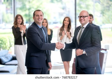 Two formal guys having a handshake