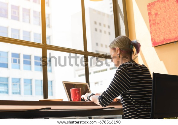 Two freelance working in coffee shop, Nomad worker conceptual, couple work together in cafe with laptop