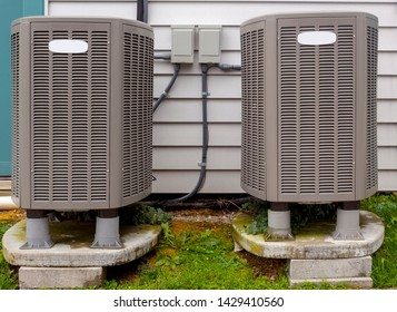 Two freestanding outdoor air conditioning units.