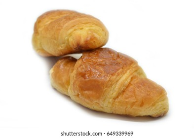 Two French croissants isolated on white background