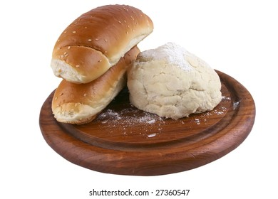 two french loaf and white dough on wood