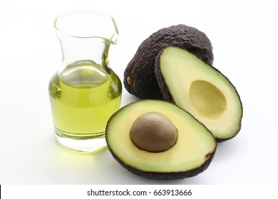 Two fresh avocado and avocado oil on white background/ Avocado and avocado oil