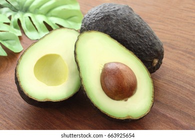 Two fresh avocado on wood background/ Avocado