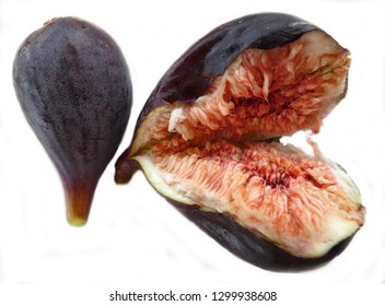 Two fresh figs on white, one burst in half