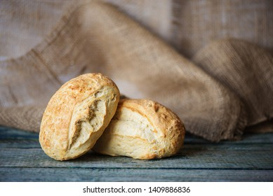 Two fresh homemade bread ciabatta on the background of rough burlap, with copy-space. Ciabatta is tradition italian bakery product