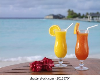 two fresh juices on the table on the beach, summer, vacation, ocean, recreation