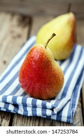 Two fresh organic pears on wooden board