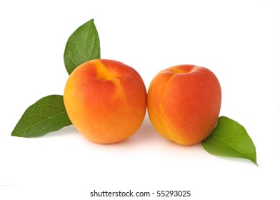 Two fresh, ripe apricots on white background