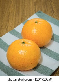 Two Fresh Ripe and Sweet Oranges on A Wooden Table, Orange Is The Fruit of The Citrus Species.