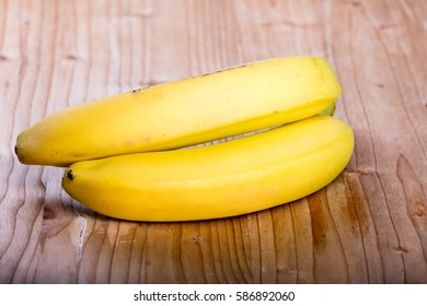 Two fresh ripe yellow bananas