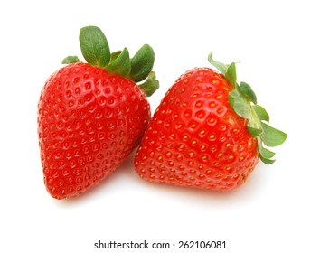 Two fresh strawberries isolated on a white background