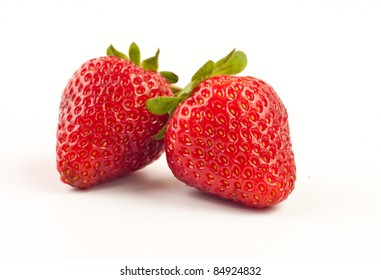 Two fresh strawberries isolated on white background