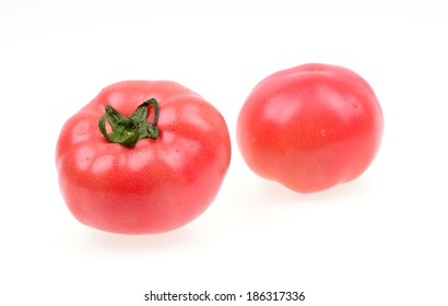 Two fresh tomatoes on a white background