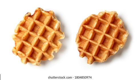 two freshly baked belgian waffles isolated on white background, top view